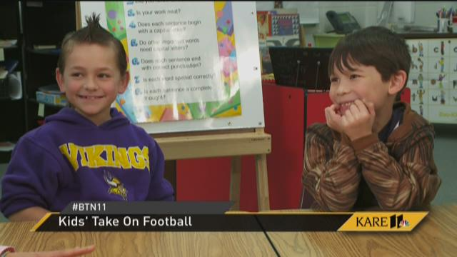 Kids talk football with Jana