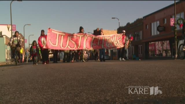 Marchers mark Jamar Clark shooting anniversary