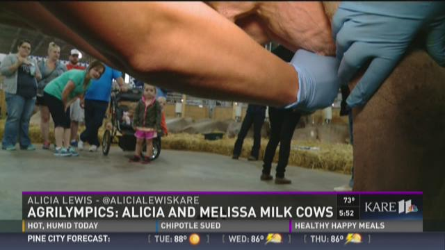 Agrilympics: Alicia and Melissa milk cows