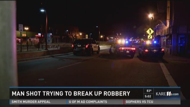Man shot trying to break up robbery